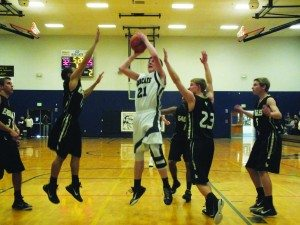 Junior Jonathan Gust goes up for a jump shot in the Bobcats' 63-49 home win over lake Mead on Saturday.