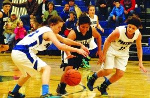 Haylee Andre dribbles through two Pahranagat Valley defenders in the  Ladycats 49-27 road win on Dec. 30.  (Dave Maxell photo)
