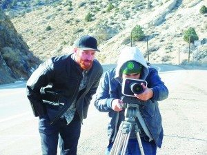 Ely native and independent filmmaker Dutch Marich looks over the shoulder of his Director of Photography Miguel Ordaz as he frame a shot on his camera.