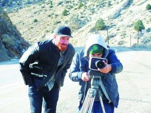 Ely native and independent filmmaker Dutch Marich looks over the shoulder of his Director of Photography Miguel Ordaz as he frame a shot on his camera. (Garrett Estrada photo)