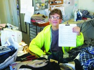 City of Ely Mayor Melody Van Camp holds up a copy of all the recall signatures inside her office and business Sew Krazy.