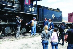 Mark Bassett speaks with the cast of Rick's Restorations when the show came to film an episode at the railroad in 2014. (Courtesy photo)