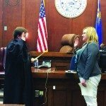 Nicole Baldwin is sworn into office as the new County Clerk by Judge Steve Bishop on Jan. 5 along with all the other public officials elected in the general election on Nov. 5, 2014. (Mike Coster photo)