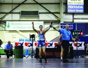 Senior White Pine wrestler Drue Ashby has his hand raised as the winner of the state finals match in the 138 pounds. weight class in Winnemucca over the weekend. (Samantha Gamberg photo)