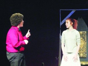 Will Hampton and Katrina Groff rehearse their scenes in the high school theater for their upcoming adaptation of Shakespeare's Hamlet. (Garrett Estrada photo)