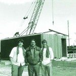 Shane, Burrell and Mark Bybee pose in front of the first unit ever put in the Copper Queen's current building in 1986. (Courtesy photo)