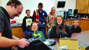 Joshua Nichols teaches Learning Bridge Chart School students how to build and repair computers in an after school class.  (Courtesy photo)