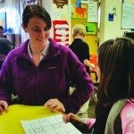 Learning Bridge Charter School teacher Lisa Harrison helps one of her students. (Courtesy photo)