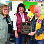 White Pine Middle School principal Sharyl Allen (left) and Ely Lions Club member Marty Westland (right) present sixth grade science teacher Susie Leyba (middle) with the Lion's Club March Teacher of the Month award. (Courtesy photo)
