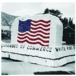 A remastered and colored photo of the Chamber of Commerce float in a Fourth of July parade from the 1960's. This year's parade will is expected to be one of the largest in recent memory with floats that tie into the multiple class reunions going on during the holiday weekend. (Courtesy photo)
