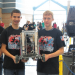 (Courtesy photo) White Pine High School students Nefi Perez and Cole Evers hold up their robot that they used to earn a first prize finish at the VEX Robotics Nevada State Championsips.