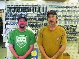 Parts Plus employee Brady Britton (left) and manager James Mossow (right) can find almost any part a car needs.