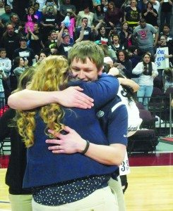 Ladycats Assistant Coach Tyler Laity hugs Head Coach Krystal Smith after White Pine won the Division III State Title.