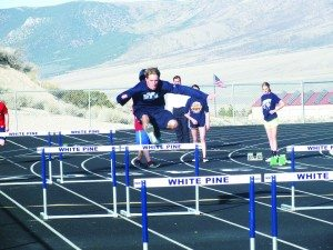 Senior Nate Lee jumps a hurdle in practice Tuesday. Lee was the highest scoring Bobcat in White Pine's first meet of the year. (Garrett Estrada Photo)