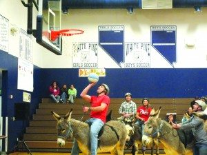 Andy Bath goes for a layup during a game of donkey basketball.
