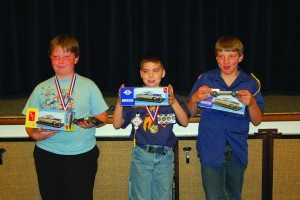 The three overall winners from the District Pinewood Derby from left to right: second place Jeremy Hallett, first place Dylan Jensen and third place Kidd Ables. (Courtesy photo)
