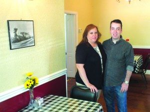 All Aboard's new owners Becky and Ralph Werber stand in the bed and breakfast's dining room.  (Garrett Estrada Photo)