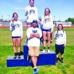 Courtesy photo White Pine Ladycats dominated the podium in the triple jump event with Mikinley Prengel taking first place, Lucy Fullmer in second place, Jenna Gubler in third place and Madeline Pickens in fourth place. Also pictured: Head coach Justin Locke.
