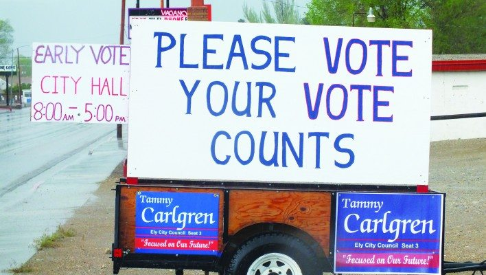 A sign off to the side of Aultman Street urges city residents to vote. Similar signs for individual candidates can be found all over town. (Garrett Estrada photo)