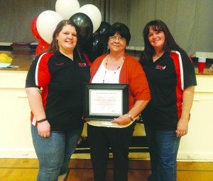 Radio station host Jodi Foster, Cathy Beckwith and KDSS President Karen Livingston stand inside the McGill Elementary gymnasium after awarding Beckwith with their monthly Angel in Disguise award.  (Courtesy photo))