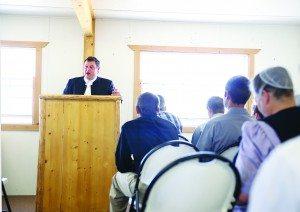 Curvin Martin leads a service at Diamond Valley Mennonite Church, April 19, 2015. (AD Hopkins photo)