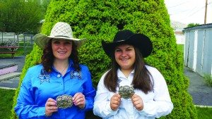 White Pine Rodeo Members Shay Zeman and Jessie Leyba hold their first place belt buckles from the state finals rodeo held in Winnemucca on May 22. (Courtesy photo)