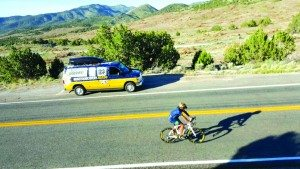 Greg Crawford rides his bicycle through White Pine County alongside a Notre Dame van headed to Reno. (Courtesy photo)