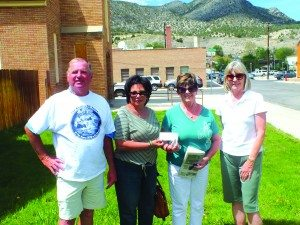 Marietta Henry and Virginia Terry receive a $6,000 donation to the Ely Renaissance Society, the largest of the donations made by the All-Class Reunion to date.