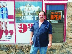 (Garrett Estrada photo) Aloha Gas Mart owner Wayne A'Bell stands in front of his new business which sits along McGill's main road.