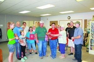 (Courtesy photo) County Commissioners Gary Perea and Carol McKenzie help cut the ribbon of the new Lund Community Center on Aug.3.