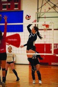 (Robert Switzer photo) White Pine Senior Ashlyn Huntington goes up to the net for a spike in the Ladycats road win over Lincoln High School.