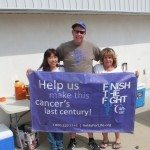 (Garrett Estrada photo) Pictured from left to right: Maki Lester, Jim Lester and Donna Lani stand in front of their wing fundraiser stand on Sept. 12.