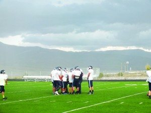 (Garrett Estrada photo) The Bobcats huddle during a rainy practice on Tuesday. Their next game after this weekend's bye will be at home against Mountain View.