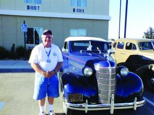 (Garrett Estrada photo) Dean Echols stands next to his 1938 Chevrolet Coupe outside of the La Quinta. Eachols said that he loves the 1938 model and owns eight of them himself.