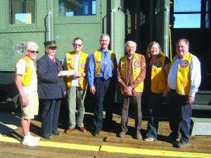(Ken Curto photo) Pictured left to right: Art Olson, Conductor Bill Hohlt, Larry Dunton, Paul Johnson, Bob Marcum, Melissa Brown and Mark Bechtel.