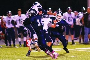 Robert Switzer photo A White Pine player makes a tackle against Meadows.