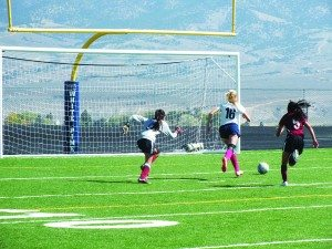 Garrett Estrada photo Lucy Fullmer runs past the West Wendover goalie to score her first of two goals in the Saturday's win.