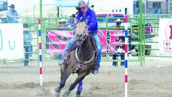 Robert Switzer photo Shay Zeman competes in the pole bending event at the White Pine County Fairgrounds.
