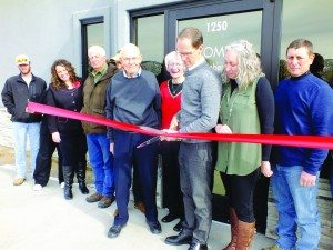 Ross Johnson photo Dr. Kent Robertson cuts the ribbon for his grand opening welcoming the community to his new office.