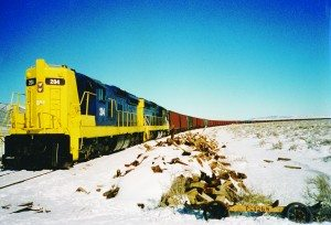 Bob Timko photo It is January 1999, Locomotive 204 is on the point of a train of 129 empty rail cars being delivered to Ely for the mine. Each car can carry three truckloads of concentrate. That means those cars can handle 387 truckloads worth of concentrate.