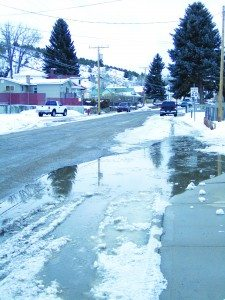 Ross Johnson photo The recent rise in temperatures is melting the snow during the day and has run the water over the curb in front of the Ely Times building. The cold temperatures at night then freeze the water creating a huge area of ice.