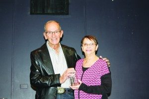 Ernie Flangas with  recipient Rosemary Reinertson of the Ely Renaissance Society.