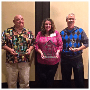 Courtesy photos Bob Dolezal, Mary Kerner and Paul Johnson with their awards at the Nevada Association of School Boards conference.