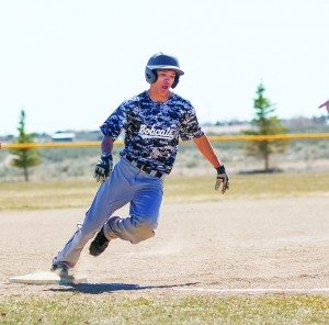 Bob Switzer photo  Junior Dekoda Barela rounds third base against Calvary Chapel  on March 18.