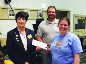 Ken Curto photo Suzanne Calhoun presenting a check for $400 to Elks Exaulted Ruler Gayle Bartlett and Est. Leading Knight Allan Lafferty.