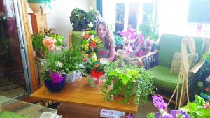 Teresa Stewart photo Cayliene Allred  is ready for Mother's Day at the Flower Basket.