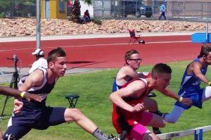 Kolton Bilbao competes in the hurdles