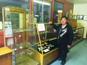 Kay Lynn Roberts-McMurray photo Laura Rainey in front of one of the displays in the gift shop.