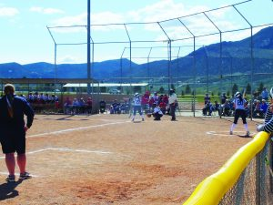 Ely Times photo Isabelle Romero up to bat against Lincoln, with Ena Lester on deck.