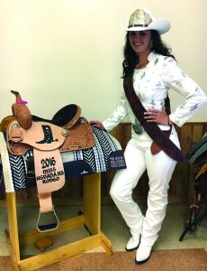Photo special to the Times Catherine Odgers is the Nevada High School Rodeo Queen and will be representing Nevada at the National Finals Rodeo, competing for the National High School Rodeo Association Queen.